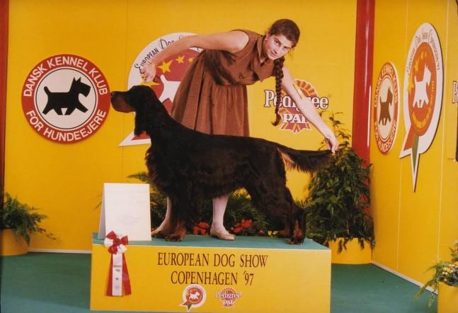 Woman posing black and tan dog