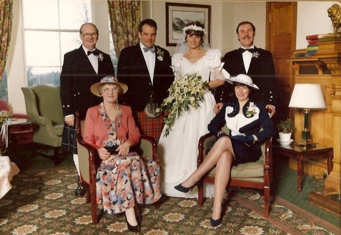 Six people in wedding finery